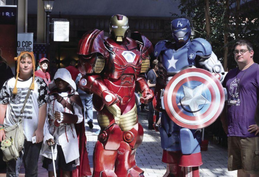 Larger Than Life: Iron Man and Captain America gather a crowd to take a picture with, including participants in the cosplay contest. The Iron Brothers of Topeka have made an appearance at Topcon every year since its debut, selling pictures and interacting with the crowd.