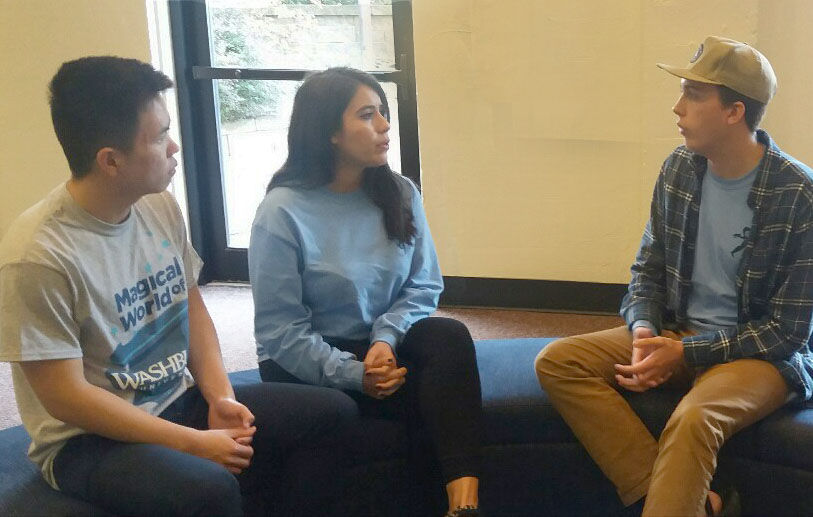(From left to right) Yun Hao Tu, Nikki Rodriguez and Zach Johnson sit and discuss the details of campus accessibility. Two resolutions passed Oct. 19 to address this issue.