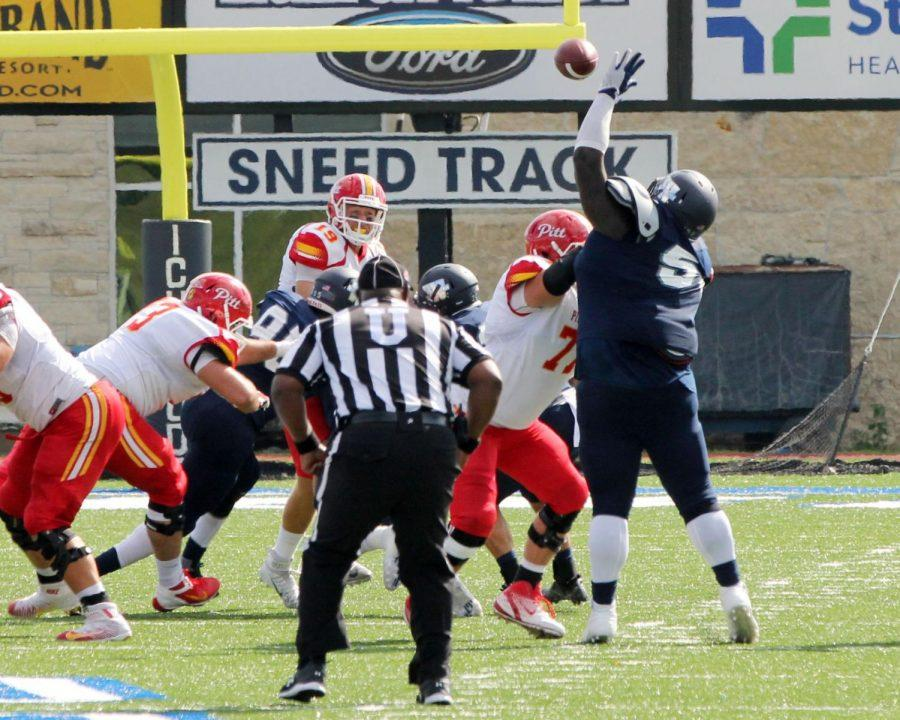 Swat 'Em: Defensive tackle, Jalen Durham, swats at Pittsburg State pass in the third quarter of a hard fought, but lost game.