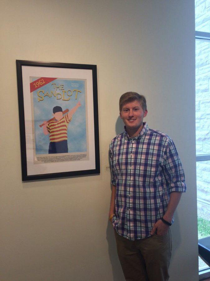 Homegrown: Senior Connor Wells poses with a homemade poster of 'The Sandlot.' Wells grew up in Topeka and looks to express himself through nostalgic work.