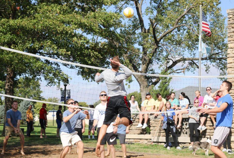 Spike: Two teams facing of in the first round of the six-on-six volleyball tournament. SAAC and Phi Delta Theta organized the tournament to raise funds for Make-a-Wish Foundation.
