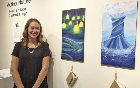 "Nurtured: Cassie Leigh remains all smiles during her senior exhibition ""Mother Nature."" Both displayed pieces are a part of Leigh's seven part acrylic series entitled ""Envisioning Creation."""