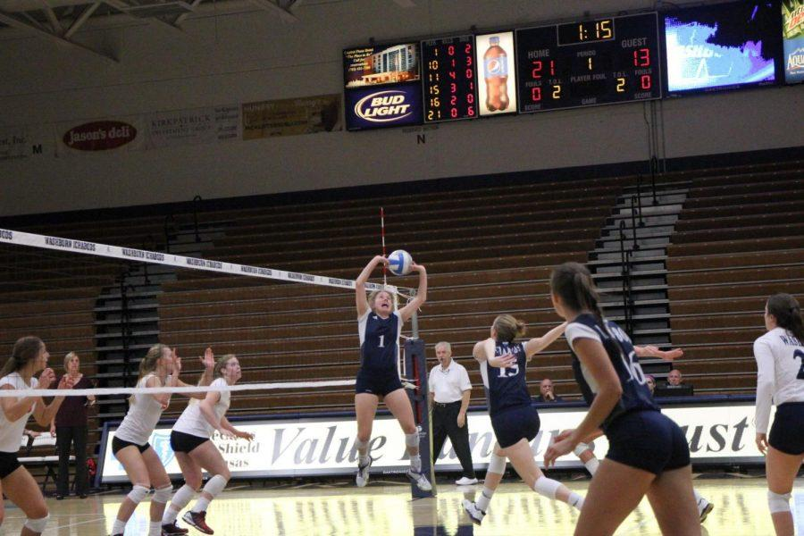 The kill: Senior Natalie Bates setting up the kill at the Pittsburgh State match at Lee Arena