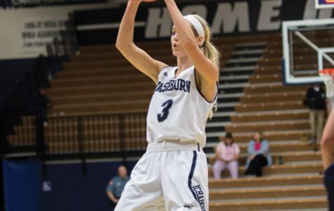 Fade away: Senior Erin Dohnalek goes for a fadeaway shot during Washburn's game against University of Saint Mary. Dohnalek is a forward and scored a total of five points over the course of the game.