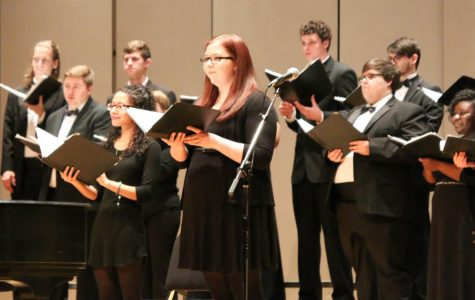 """Soloing Singers: Mary Stithem and Sienna Haynes, sopranos, ending their performance of """"Pie Jesu"""" from Andrew Lloyd Webber's """"Requiem."""" Haynes and Stithem performed as soloists during both """"Pie Jesu"""" and """"Song of Days Now Gone"""" from Donald McCullough's """"Holocaust Cantata."""""""
