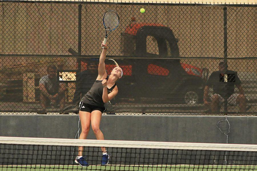 Tennis%3A+Logan+Morrissey+jumps+for+the+ball+during+her+April+12+doubles+match+against+Baker+University.