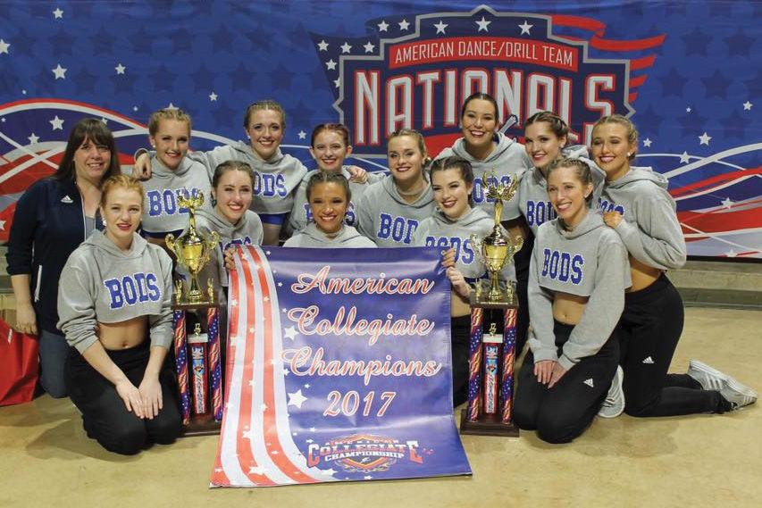 Three-time+champs%3A+The+Washburn+Dancing+Blues+celebrate+victory.+The+dance+team+won+first+place+in+the+open+category+and+runner+up+in+the+hip-hop+category+of+the+American+Dance+and+Drill+Team+Collegiate+National+Championship.