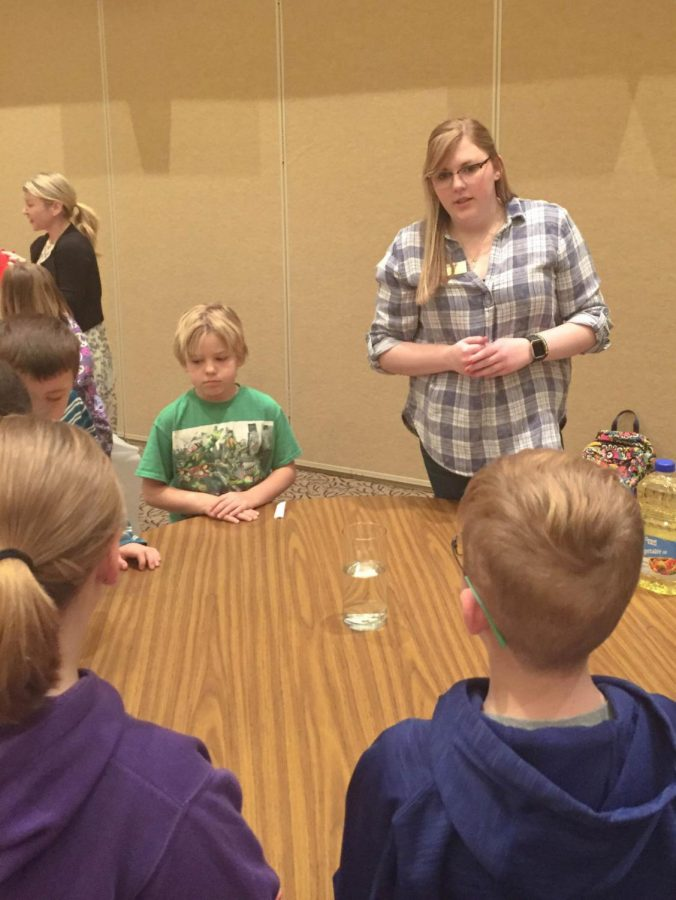 Shelby Dodds, junior education major, instructs her student's on the experiment. This event allowed Dodds the opportunity to practice hands-on teaching.