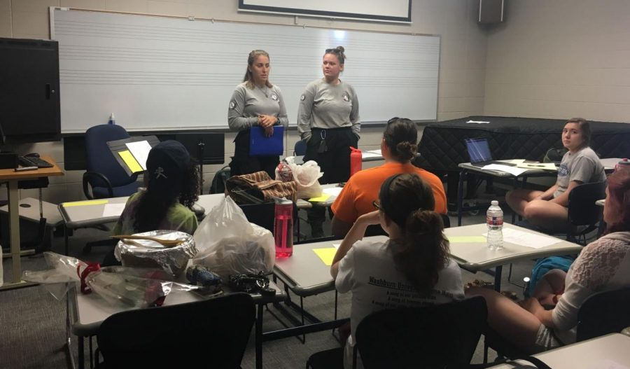 AmeriCorps members Julie Engle and Nicole Fogg talk to members of WU's Sigma Alpha Iota chapter about volunteering at Forest Park's free summer day camp.