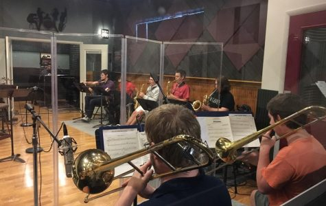 WU Jazz Orchestra students warm up before their second day of recording at BRC Audio Productions.