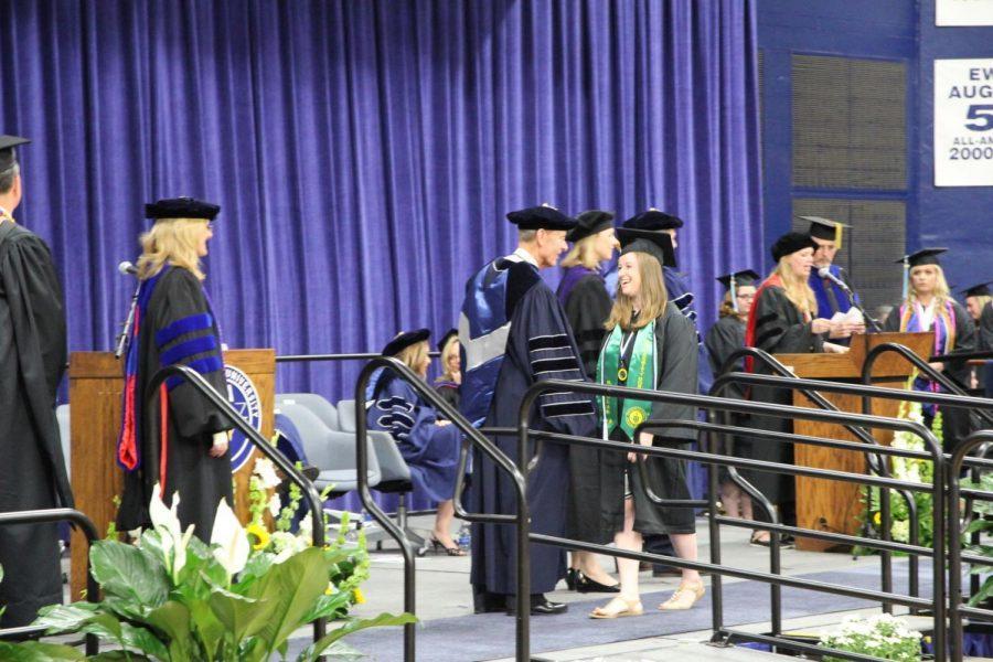 President Jerry Farley congratulates mass media graduate Carney Ziegler, who graduates Summa Cum Laude with university honors.