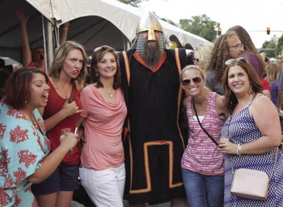 Attendees posing with a member of Norsemen Brewing Company. Norsemen operates a tap room in NOTO Arts District.