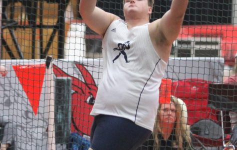 Michael Majors competing in shot put. Majors is a sophomore planning to major in business.