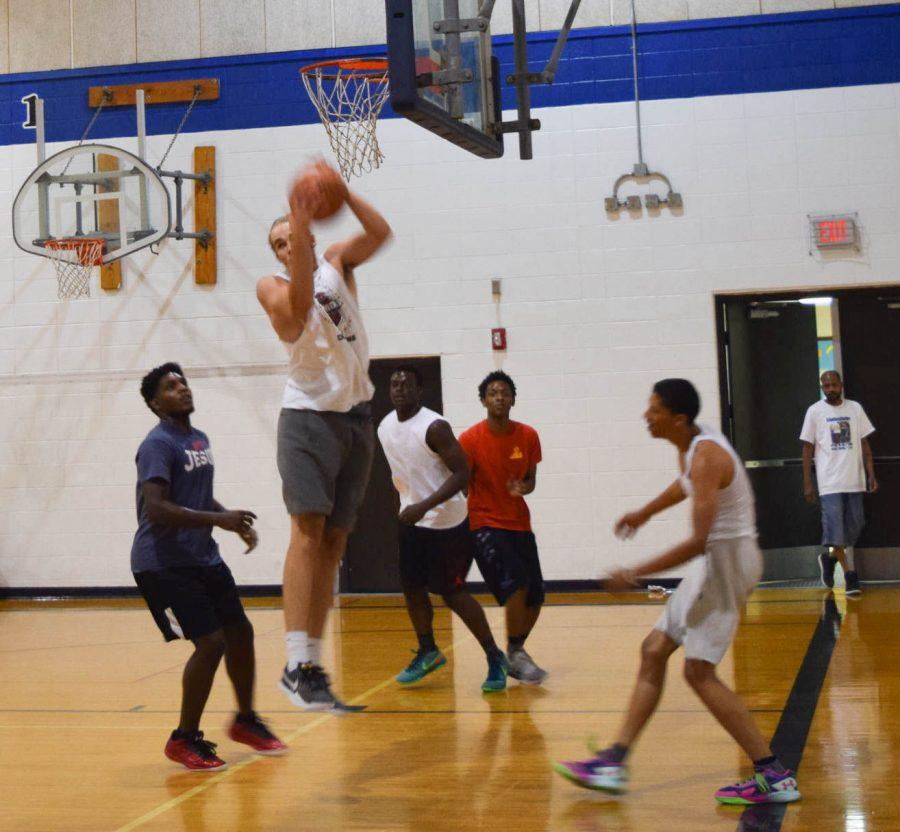 A player from one of the 13 teams competing goes up to grab a rebound during a game.
