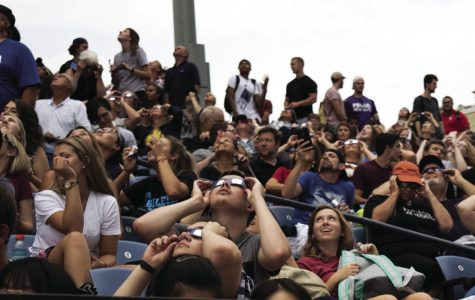 Eye to the Sky: Washburn students gather together at Yager Stadium to view the solar eclipse. Despite the cloudy weather, Ichabods were able to catch brief glimpses of the event.