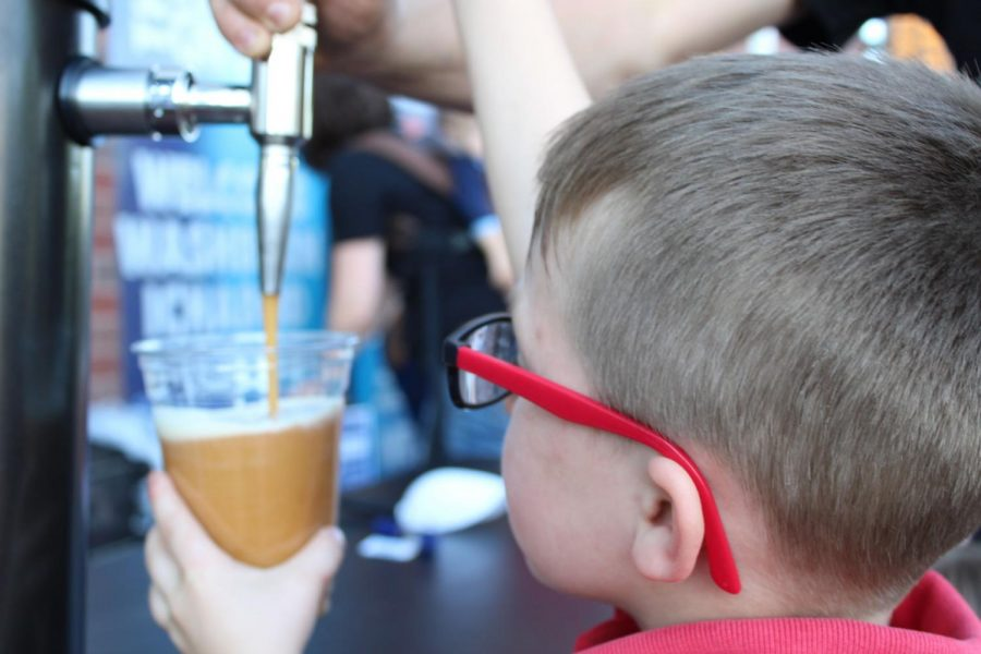 Nitro Freshness:A boy fills his cup with CaféBarnabas' nitro chai to stay fresh. The nitrogen-infused drink is a new item on the tea hub's menu.
