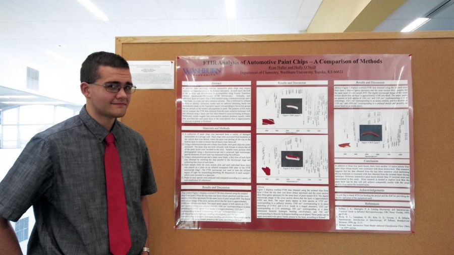 Chipper: Ryan Haller, chemistry major, displays his research on paint chips from cars. His research focused on how these methods can be used to determine different makes of automotive vehicles.