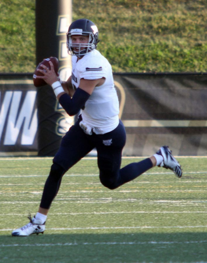 Sophomore+quarterback+Blake+Peterson+rolls+out+looking+for+a+receiver+in+Washburn%E2%80%99s+26-16+win+over+Lindenwood+Saturday+night+in+St.+Charles%2C+Missouri.