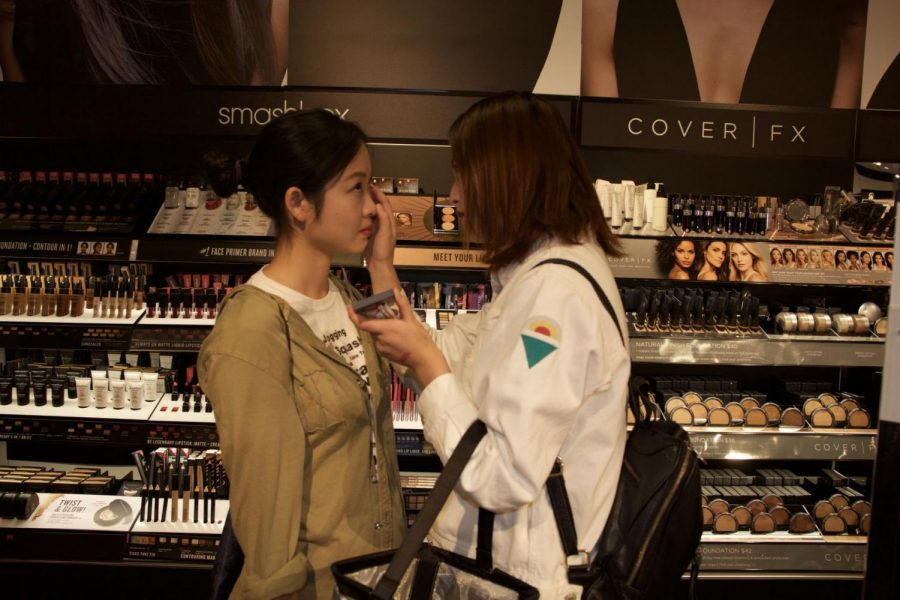 Glow up: Two happy customers sample cosmetic products available at the new Sephora.