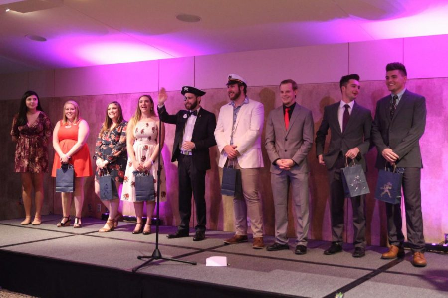 The final candidates are announced to the audience. From left to right: Crystal Huereca-Retana, Jenny Lieurance, Leah Coons, Caroline Clark, Zac Surrit, Scott Weinkauff, Travis Thayer, Skyler Urban, Cameron Thomas. Not pictured: Alexis Yelland.