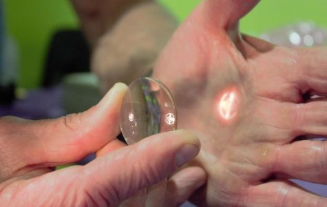 Let there be light:Dr Chris Orensen demonstrates how light can be manipulated by lenses.