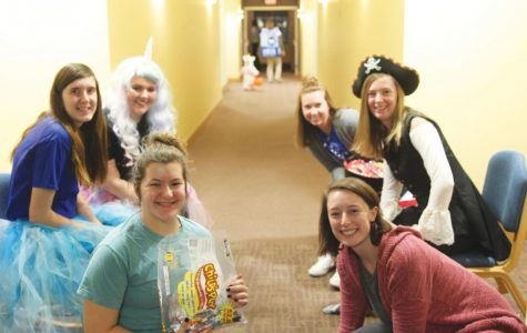 Trick-or-treaters in residence halls get candy, give cans