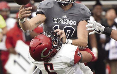 Washburn quarterback Blake Peterson fumbles the ball against Central Missouri.