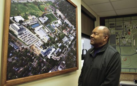 Lay of the Land: Eric Moss looks at a map of the campus. Moss has to be familiar with the lay of Washburn's land as the assistant director of Facility services