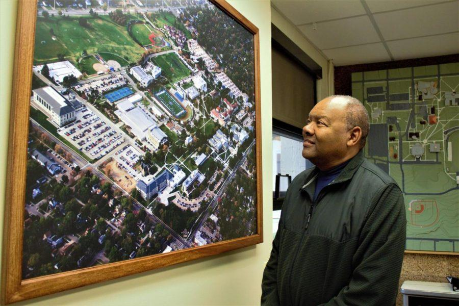 Lay of the Land:Eric Moss looks at a map of the campus.