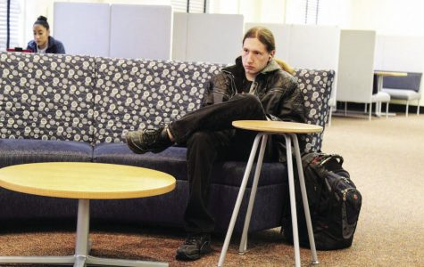 Patience: Waiting for the next presentation on gender identity to begin, Adam Thew, sophomore business major, sits in the Union Underground. Tea, coffee and cookies were free to all students attending.