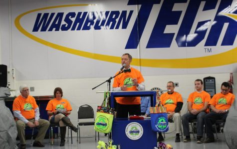 Washburn University President Jerry Farley addresses the crowd during Washburn Tech's Recycled Rides unveiling. Washburn University worked through a partnership with Washburn Tech in order to repair cars for members of Topeka's community.
