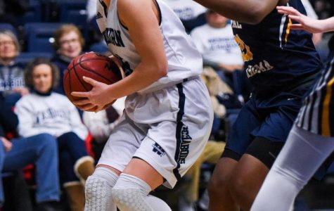 Sophomore guard Alexis McAfee looks for help as she drives in against Central Oklahoma on Saturday, Jan. 13 at Lee Arena.