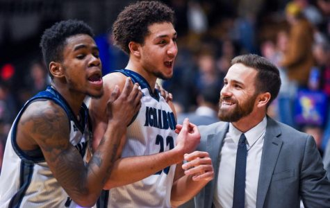 Javion Blake, Brady Skeens, and Assistant Coach Joe Balestrieri celebrate as they leave the court after the victory against Central Oklahoma on Saturday, Jan. 13 at Lee Arena.