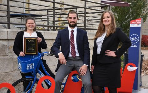 Business students from left, Maureen Dombrow, Matthew Hicks and Liberty Beecham pose with Topeka Metro Bikes. These students won the