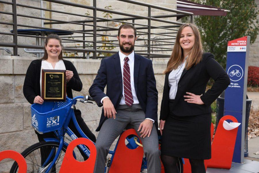 Business+students+from+left%2C+Maureen+Dombrow%2C+Matthew+Hicks+and+Liberty+Beecham+pose+with+Topeka+Metro+Bikes.+These+students+won+the+%22Best+Undergraduate+Paper+Award%22+from+American+Accounting+Association+in+2017.+%C2%A0