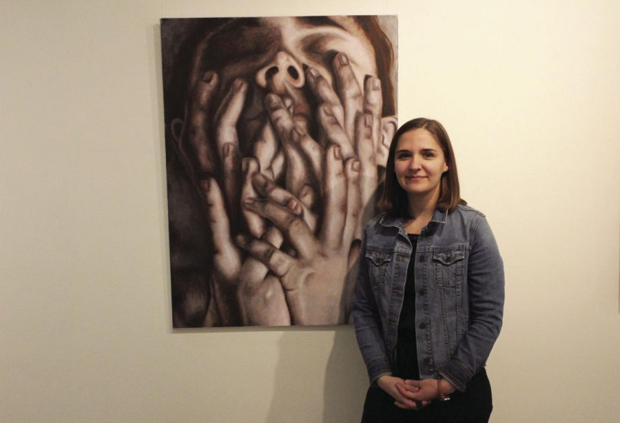 Proud+artist%3A+Jenna+Reed+stands+in+front+of+her+favorite+painting+in+the+exhibition%2C+titled+%E2%80%9COverwhelmed.%E2%80%9D+Reed%E2%80%99s+work+will+continue+to+be+displayed+in+the+art+building+until+Feb.+23.