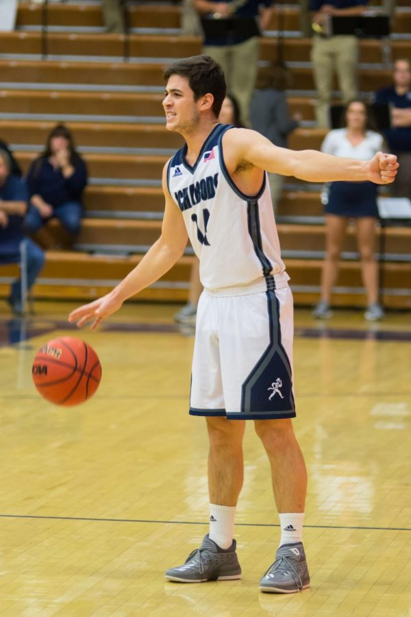Tom+Huppe+looks+to+pass+during+an+Ichabod+basketball+game+during+MIAA+conference+play.