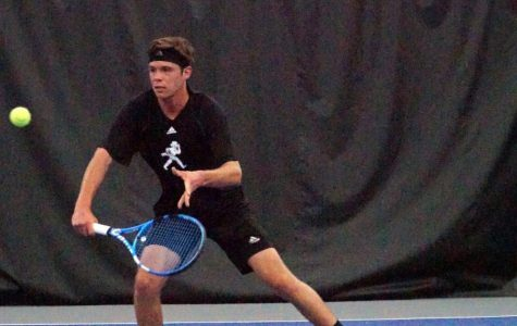 Freshman Bradley Eidenmueller slices a volley during his singles match against the Southwest Baptist Bearcats.