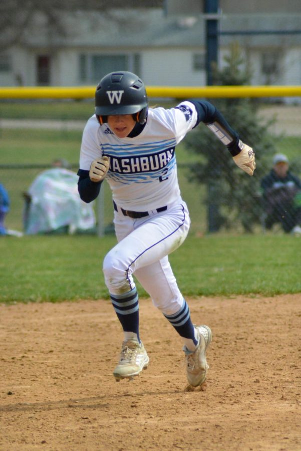 Taking+off%3A+Junior+outfielder+Samantha+Stallbaumer+takes+third+base+to+score+in+another+run+against+Emporia+State+at+the+Washburn+Softball+Complex.
