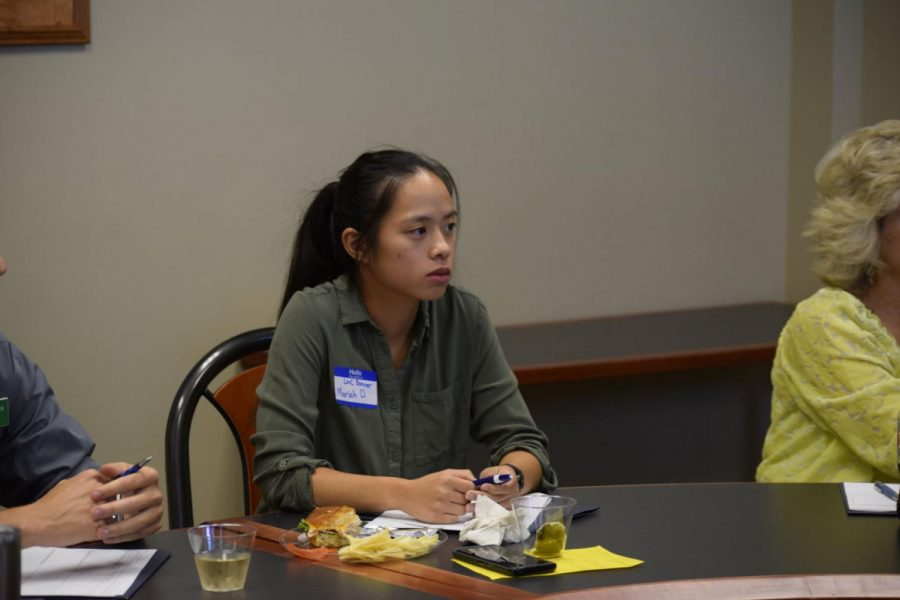Junior Mariah Debacker sits in and joins the breakout group discussing dependent care. The group is planning to organize a summit to bring the issues they discussed to the greater community.
