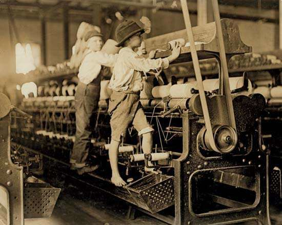 Sweat Shop: Young children working in a thread spinning mill in Macon, Georgia, 1909.