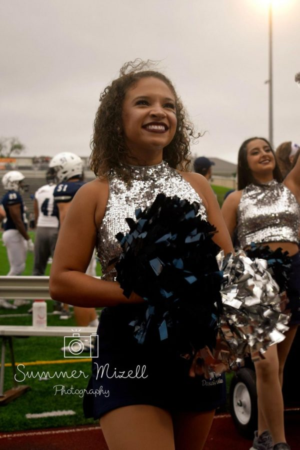 Feeling Blue.Senior captain Michaela Trobough cheers on the Ichabods. Trobough has been a member of the Dancing Blues for the past four years.