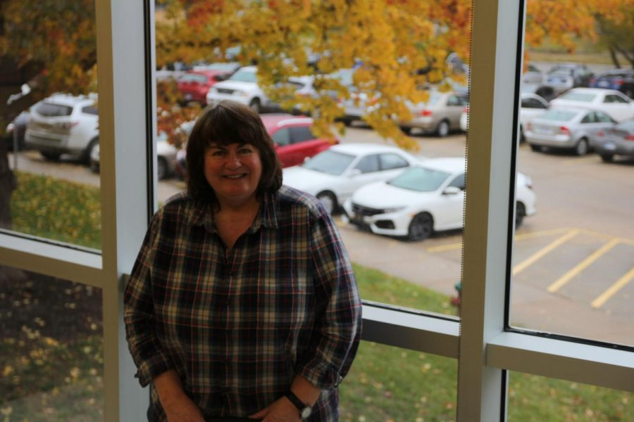 Photo for Fall: Tambra Eifert poses in front of the scenic view her classroom overlooks.
