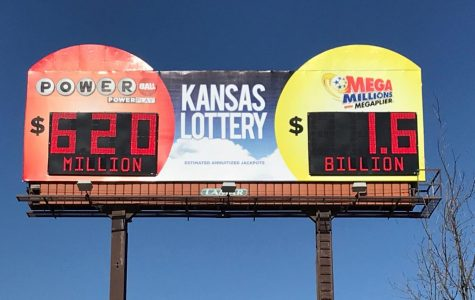 Chicken dinner: A billboard shows the record $1.6 Mega Millions jackpot and the also abnormally high $620 million Powerball. Kansans spent almost $6.3 million purchasing tickets to these two lotteries last week.