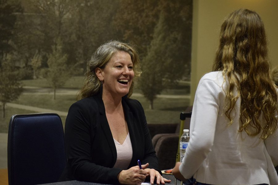 """Reading, writing, no arithmetic: Author Melanie Crowder meets with students and signs books at the Literature Festival. Students read either """"Three Pennies"""" or """"Audacity"""" by Crowder before attending the festival at WU."""