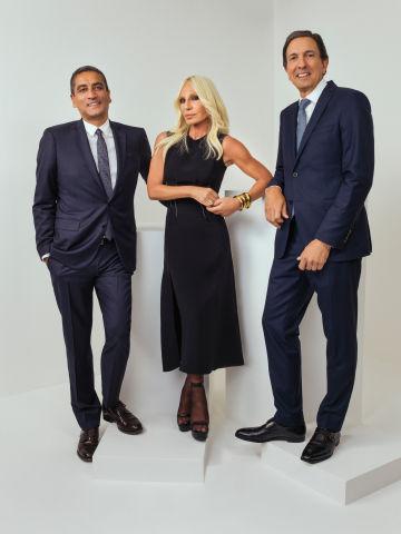 Jonathan Akeroyd, chief executive of Versace, Donatella Versace, vice president of Versace, and John D. Idol, chief executive of Capri Holdings.