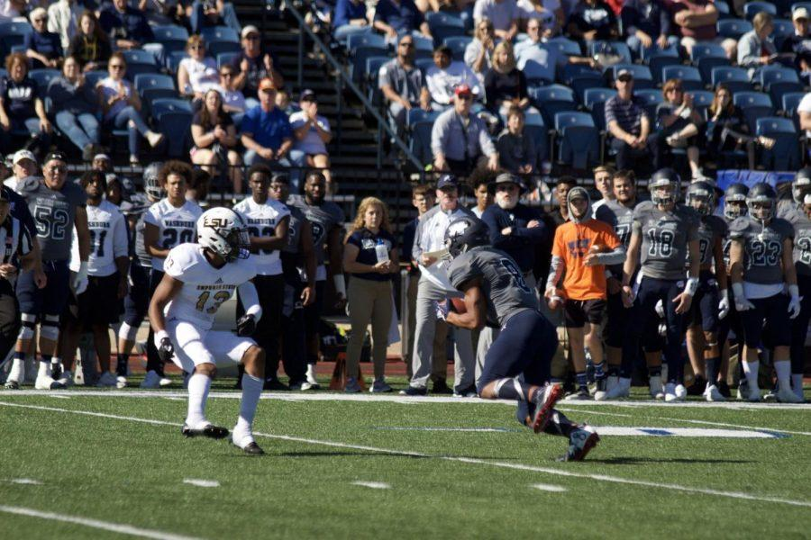 Going for six: Senior wide receiver James Brania-Hopp, hauls in one of his many catches of the day. The Ichabods lost to Emporia State, 34-31.