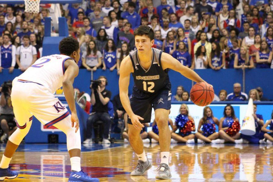 CROSSOVER%3A%C2%A0Sophomore+Tyler+Geiman+looks+to+cross+up+the+KU+defender+in+the+exhibition+game+at+Allen+Fieldhouse+earlier+this+year.+Geiman+broke+the+Blue+Valley+High+School+assist+record+during+his+time+in+high+school.
