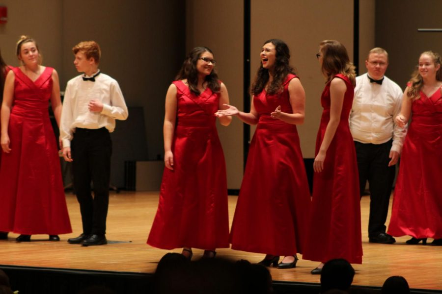 Singing+showcase%3A+A+trio+from+the+Shawnee+Heights+Choraliers+sing+during+an+especially+narrative+performance.+The+concert+was+a+good+way+to+see+what+types+of+music+the+schools+were+working+on.