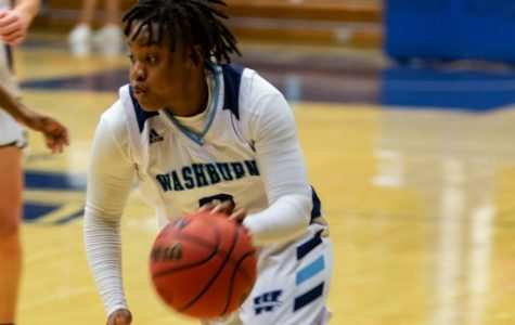 Ball out: Shelbe Piggie makes her way up the court. Washburn Women's Basketball won their game Saturday, Dec. 8, against the Mules.